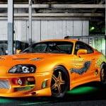orange_toyota_supra_neon-wallpaper-1366x768